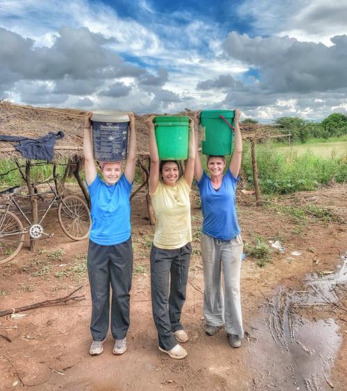 elisabeth with water buckets